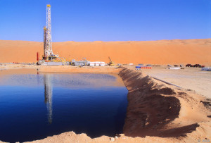 Production drilling rig in Saudi Arabia's Shaybah Oil Field.  Crude oil from wells is degassed before entering the pipline to Abqaiq, some 600 km away.  This is one of the newest and most remote oilfields in Saudi Arabia and it produces 550,000 barrels of oil per day.