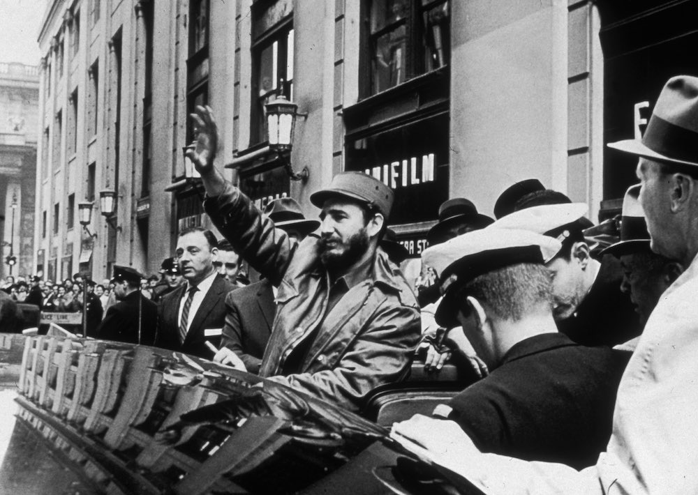 25th April 1959: Cuban president Fidel Castro waves to crowds on his way to Pennsylvania Station from the Statler Hilton Hotel in New York City, en route to Boston. (Photo by Carl T. Gossett Jr/New York Times Co./Getty Images)
